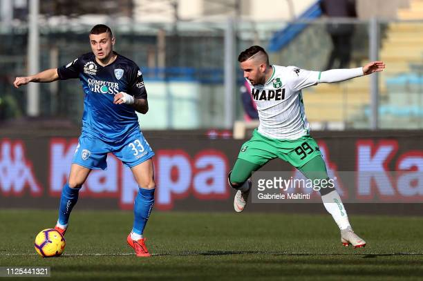 Rade Krunic of Empoli FC battles for the ball with Enrico Brignola of US Sassuolo during the Serie A match between Empoli and US Sassuolo at Stadio...