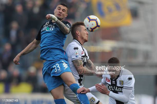 Rade Krunic of Empoli FC battles for the ball with Juray Kucka of Parma Calcio during the Serie A match between Empoli and Parma Calcio at Stadio...