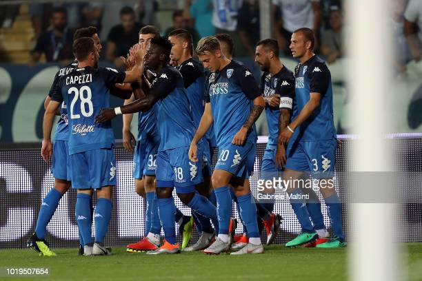 Rade Krunic of Empoli FC celebrates with teammates after scoring a goal during the serie A match between Empoli and Cagliari at Stadio Carlo...