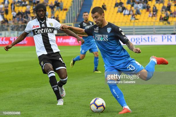 Rade Krunic of Empoli FC competes for the ball with Gervinho of Parma Calcioduring the Serie A match between Parma Calcio and Empoli at Stadio Ennio...