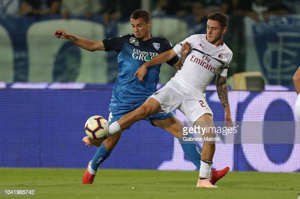Rade Krunic of Empoli FC fights for the ball with Davide Calabria of AC Milan during the serie A match between Empoli and AC Milan at Stadio Carlo...