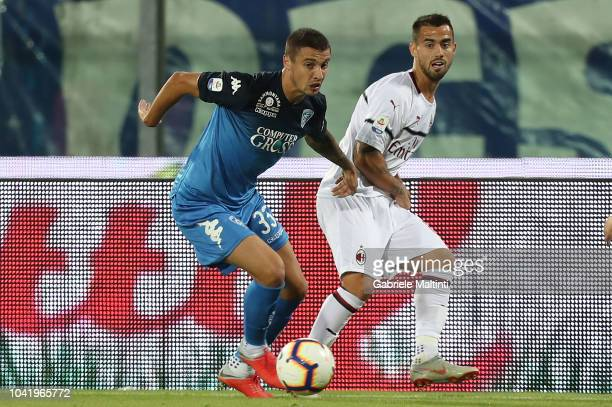 Rade Krunic of Empoli FC fights for the ball with Suso of AC Milan during the serie A match between Empoli and AC Milan at Stadio Carlo Castellani on...