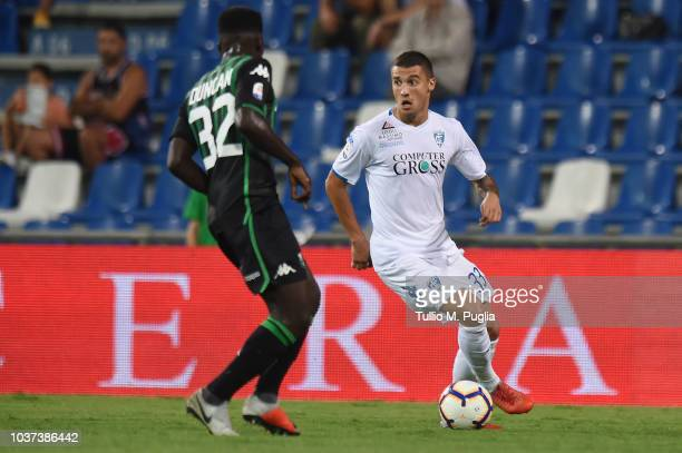 Rade Krunic of Empoli is challenged by Alfrerd Duncan of Sassuolo during the serie A match between US Sassuolo and Empoli at Mapei Stadium Citta' del...