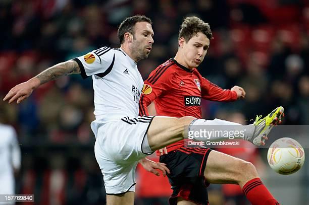 Rade Prica of Rosenborg Trondheim and Philipp Wollscheid of Leverkusen battle for the ball during the UEFA Europa League Group K match between Bayer...