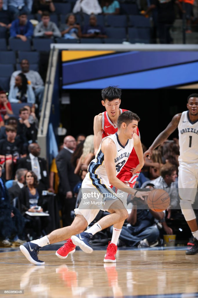 Rade Zagorac #52 of the Memphis Grizzlies handles the ball against Zhou Qi #9 of the Houston Rockets during a preseason game on October 11, 2017 at FedExForum in Memphis, Tennessee.