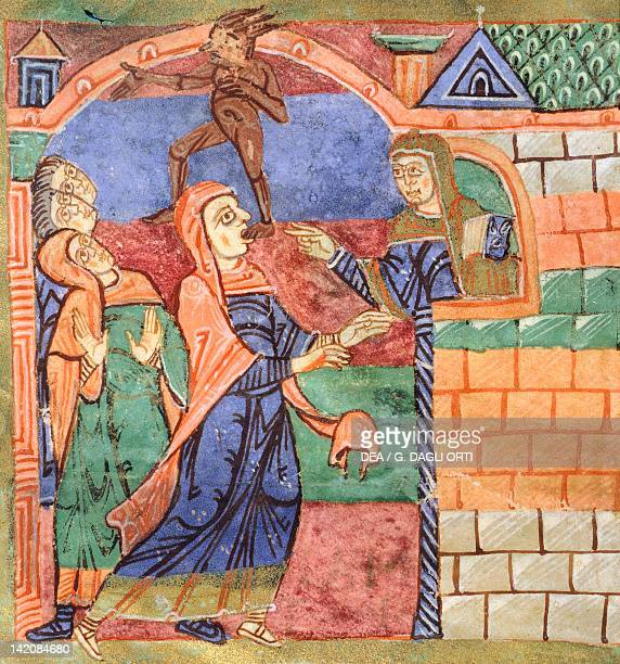 Radegunda freeing a person of a demon miniature from the Life of Saint Radegunda illumination from Poitiers Abbey of Saint Croix manuscript France...