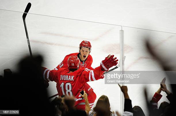 Radek Dvorak and Jeff Skinner of the Carolina Hurricanes celebrate Dvorak's goal againt the Detroit Red Wings during th first period at PNC Arena on...
