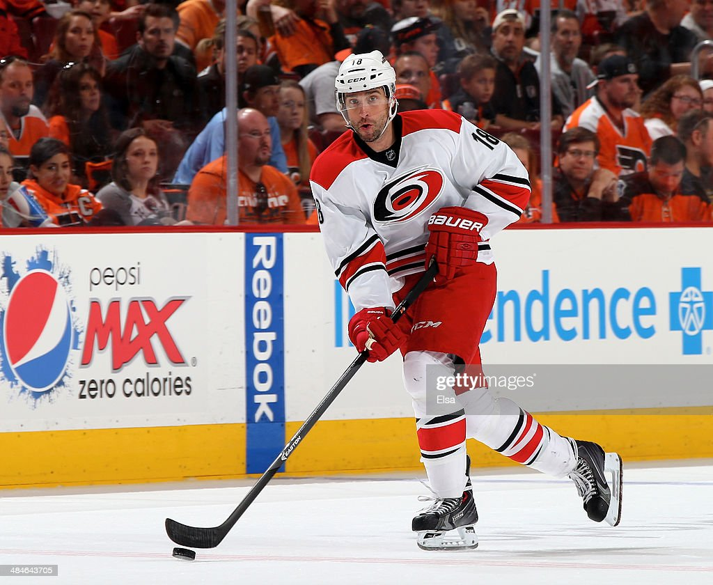 Radek Dvorak #18 of the Carolina Hurricanes takes the puck in the third period against the Philadelphia Flyers at Wells Fargo Center on April 13, 2014 in Philadelphia, Pennsylvania.The Carolina Hurricanes defeated the Philadelphia Flyers 6-5 in an overtime shootout.