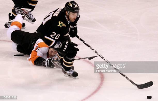 Radek Dvorak of the Dallas Stars skates the puck past James van Riemsdyk of the Philadelphia Flyers at American Airlines Center on December 21 2011...