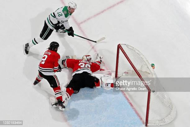 Radek Faksa of the Dallas Stars scores a goal past Duncan Keith and Kevin Lankinen of the Chicago Blackhawks in the third period at the United Center...