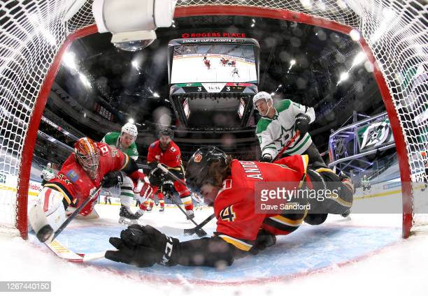 Radek Faksa of the Dallas Stars scores a power play goal on goaltender Cam Talbot of the Calgary Flames as Rasmus Andersson reaches to stop the puck...