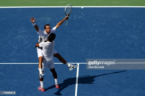 Radek Stepanek of Czech Republic and Leander Paes of India celebrate match point during their men's doubles semifinal match against Bob Bryan and...