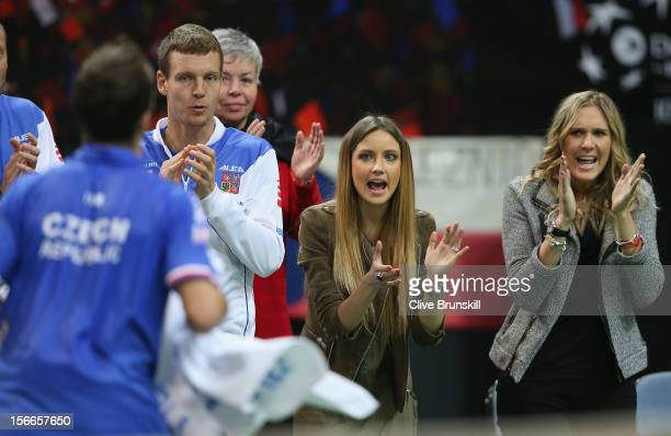 Radek Stepanek of Czech Republic is cheered on by his wife Nicole Vaidasova, team mate Tomas Berdych and his girlfriend Ester Satorova during the...
