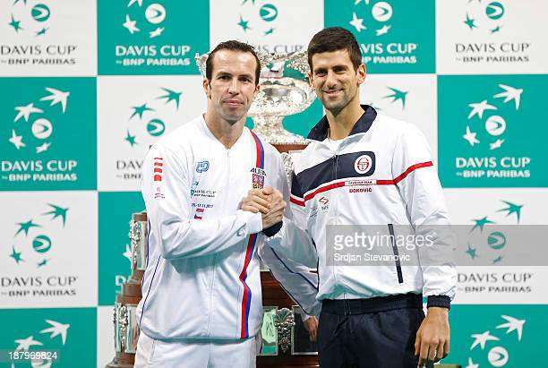 Radek Stepanek of Czech Republic shakes hands with first day opponent Novak Djokovic of Serbia during a draw ceremony prior to the Davis Cup final...