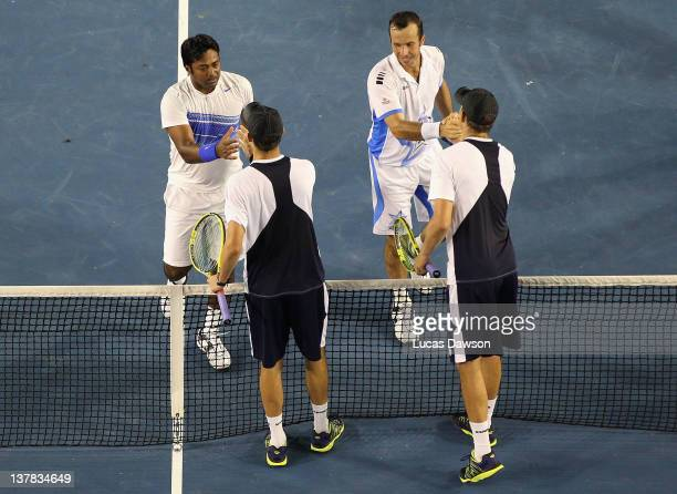 Radek Stepanek of the Czech Republic and Leander Paes of India celebrate championship point after winning their mens' doubles final match against Bob...