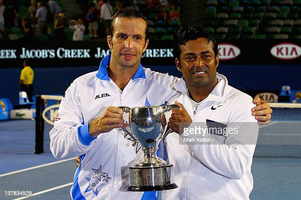 Radek Stepanek of the Czech Republic and Leander Paes of India pose pose with the trophy after winning their men's doubles final match against Bob...