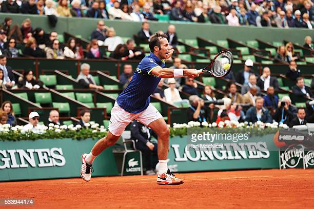 Radek Stepanek of the Czech Republic plays a shot during the Men's Singles first round match against Andy Murray of Great Britain on day three of the...