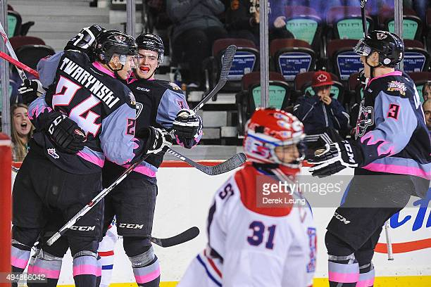 Radel Fazleev of the Calgary Hitmen celebrates after scoring against the Spokane Chiefs during a WHL game at Scotiabank Saddledome on October 29,...