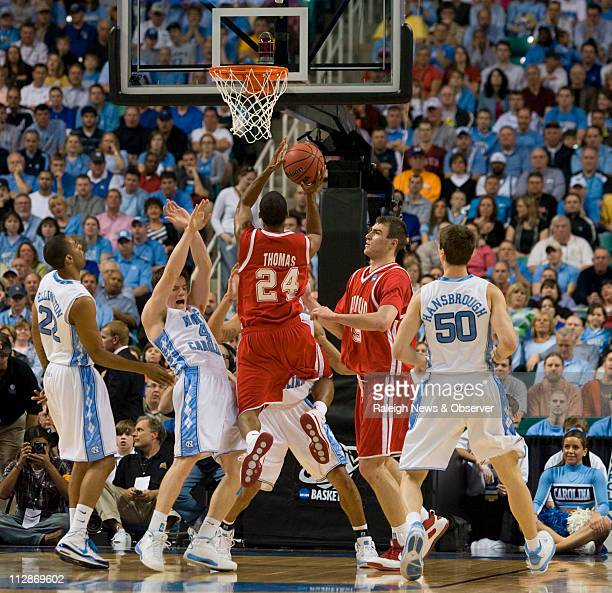 Radford's Kenny Thomas puts up a shot over North Carolina's Bobby Frasor in the first half on Thursday, March 19, 2009. The Tar Heels defeated the...