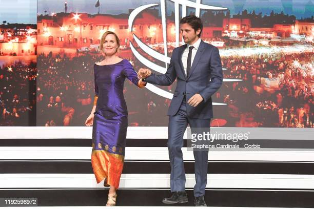 Radha Mitchell and Raphael Personnaz attend the closing ceremony during the 18th Marrakech International Film Festival on December 07 2019 in...