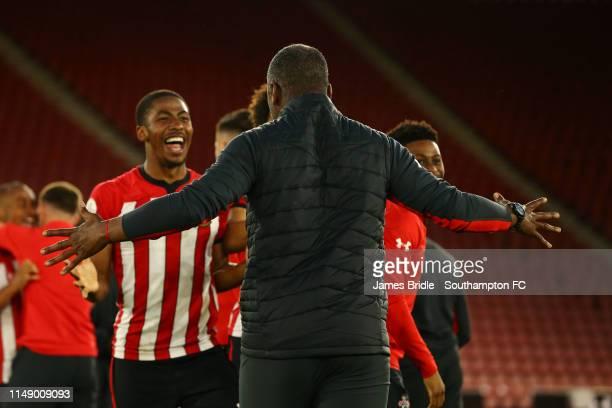 Radhi Jaidi runs to congratulate Kayne Ramsay and Oludare Olufunwa after Southampton win 21 during the U23s PL2 Play off final between Southampton...