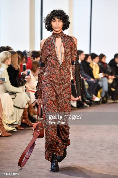 Radhika Nair walks the runway during the Chloe show as part of the Paris Fashion Week Womenswear Fall/Winter 2018/2019 on March 1 2018 in Paris France