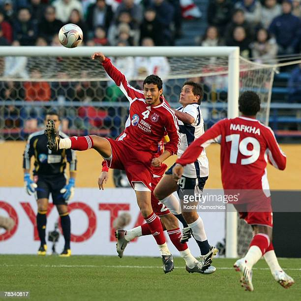 Radhouan Falhi of Etoile Sportive du Sahel and Cristian Gimenez of Pachuca compete for the ball during the FIFA Club World Cup Japan 2007 match...