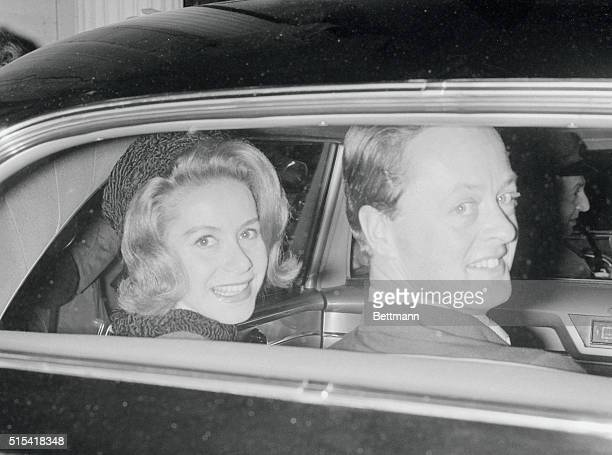 Radiant smiles light the faces of Tina Livanos and her new husband the Marquess of Blandford as they ride away after a civil marriage ceremony at the...