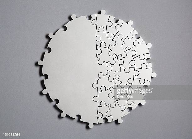 Radiating silver puzzle, half united as one piece