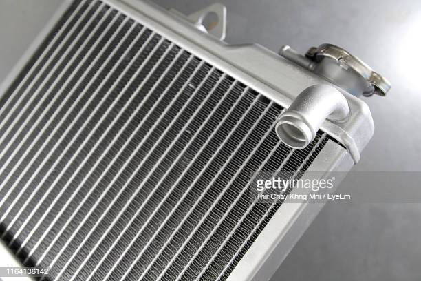 radiator against gray background - vehicle grille stock pictures, royalty-free photos & images