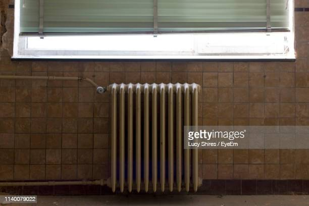radiator on wall at home - lucy shires stock pictures, royalty-free photos & images