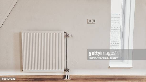 Radiator On White Wall At Home