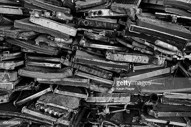 Radiators from high polluting vehicles taken off the road by authorities are seen piled up at an auto scrapyard on September 25 2015 in Zhejiang...