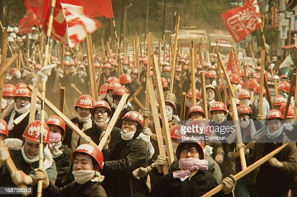 Radical left wing students with square logs who support the protest against the construction of the New Tokyo International Airport gather for the...