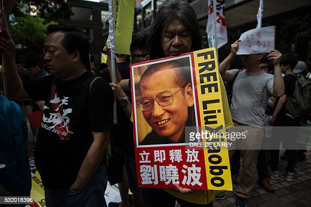 Radical legislator ÒLong HairÓ Leung Kwokhung holds a banner of Chinese dissident Liu Xiaobo during a prodemocracy protest in Hong Kong on May 18...