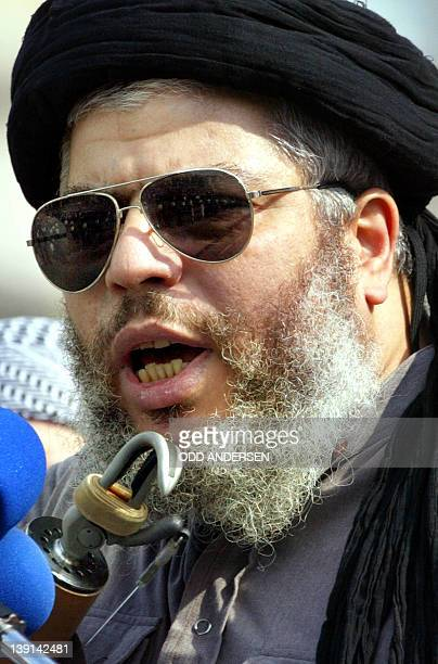 Radical muslim clergyman Sheikh Abu Hamza addresses the crowd at the 'Rally for Islam' at Trafalgar Square in central London 25 August 2002Some 400...