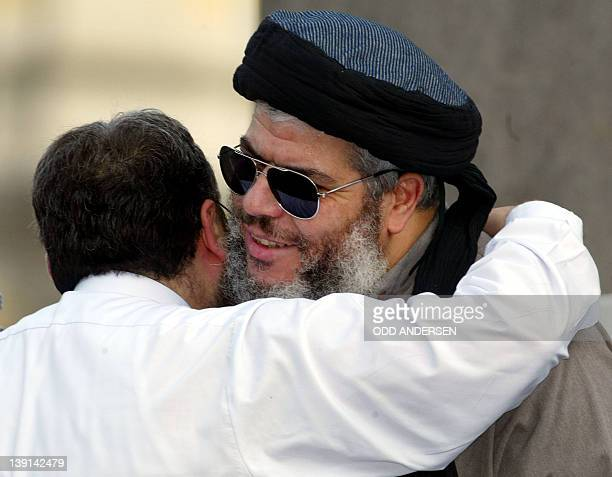 Radical muslim clergyman Sheikh Abu Hamza is greeted by fellow clergyman Sheikh Omar Bakri Muhammad at the 'Rally for Islam' at Trafalgar Square in...