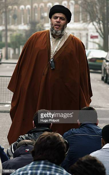 Radical Muslim Cleric Abu Hamza conducts a service of Friday afternoon prayers outside the Finsbury Park Mosque March 28 2003 in London An MP has...
