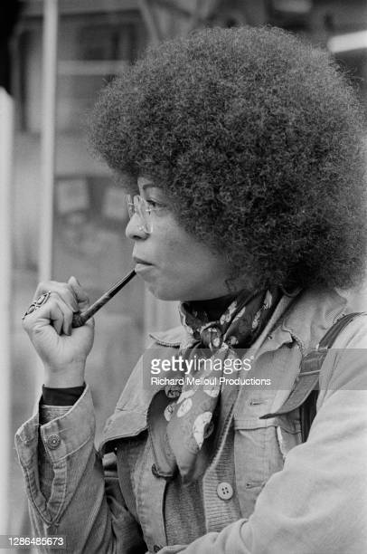 Radical political activist Angela Davis smokes a tobacco pipe in Paris where she is presenting her new book.