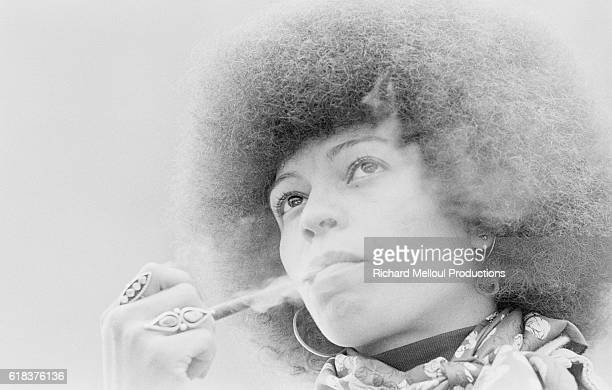 Radical political activist Angela Davis smokes a tobacco pipe in Paris where she is presenting her new book