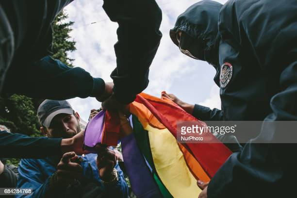 Radicals burn a rainbow flag selected from LGBT activists in Kharkov Ukraine on May 17 2017