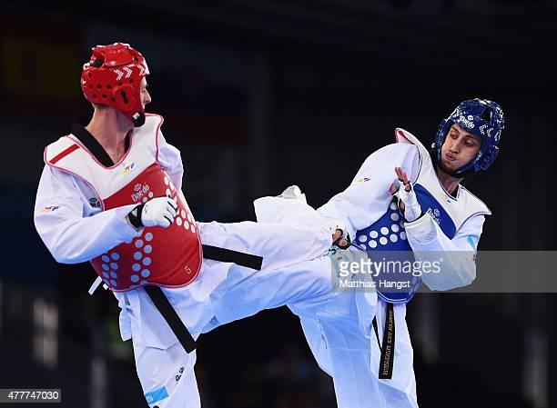 Radik Isaev of Azerbaijan and Vladislav Larin of Russia compete in the Men's 80kg Taekwondo gold medal final during day seven of the Baku 2015...