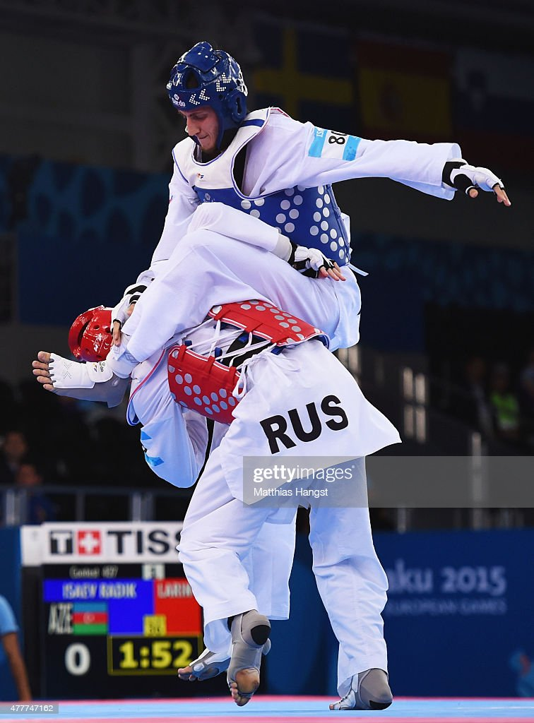Radik Isaev of Azerbaijan (blue) and Vladislav Larin of Russia (red) compete in the Men's +80kg Taekwondo gold medal final during day seven of the Baku 2015 European Games at the Crystal Hall on June 19, 2015 in Baku, Azerbaijan.