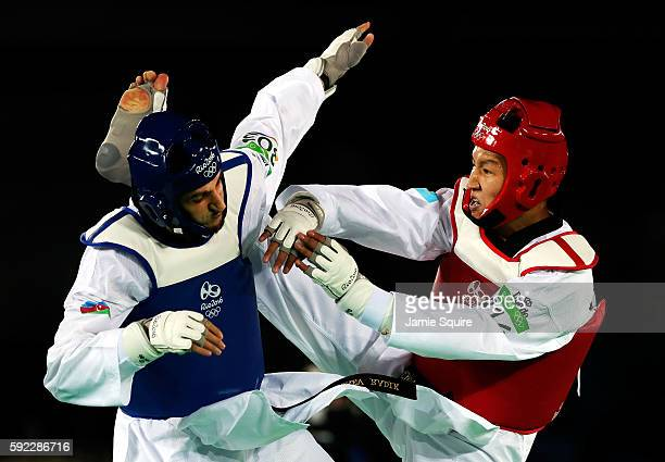 Radik Isaev of Azerbaijan competes against Rusian Zhaparov of Kazakhstan during Men's 80kg Taekwondo competition at the Rio 2016 Olympic Games on...