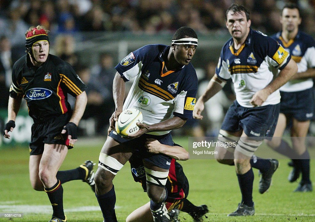 Radike Samo #4 of the Brumbies looks to offload during the Super 12 game between the Chiefs and Brumbies at Waikato Stadium in Hamilton, New Zealand on May 8, 2004. The Chiefs scored a point by finishing within 8 points of the Brumbies to go through. The Brumbies won the match 15-12.