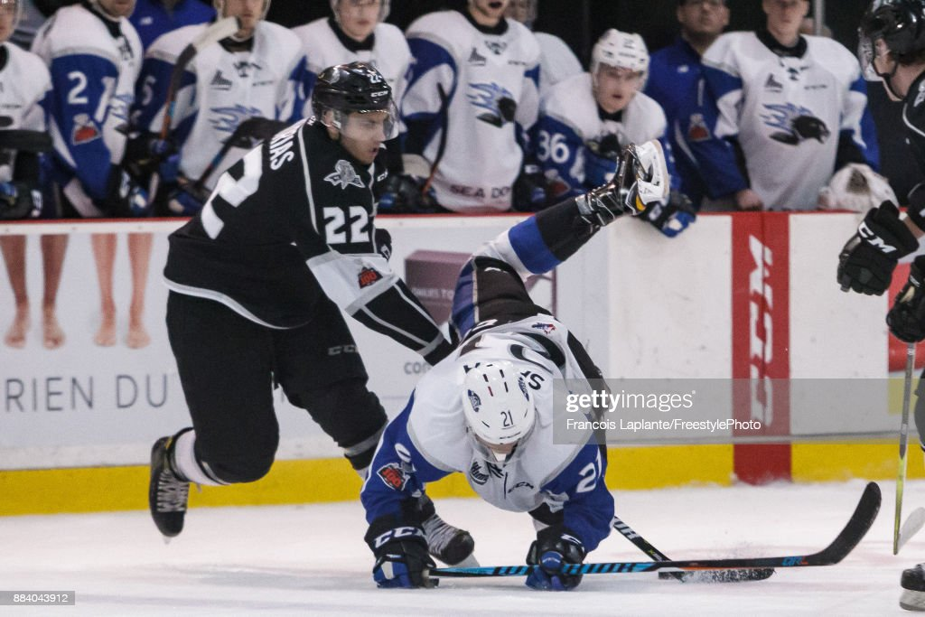 Radim Salda #21 of the Saint John Sea Dogs falls onto the ice as Shawn Boudrias #22 of the Gatineau Olympiques steals the puck away on December 1, 2017 at Robert Guertin Arena in Gatineau, Quebec, Canada.