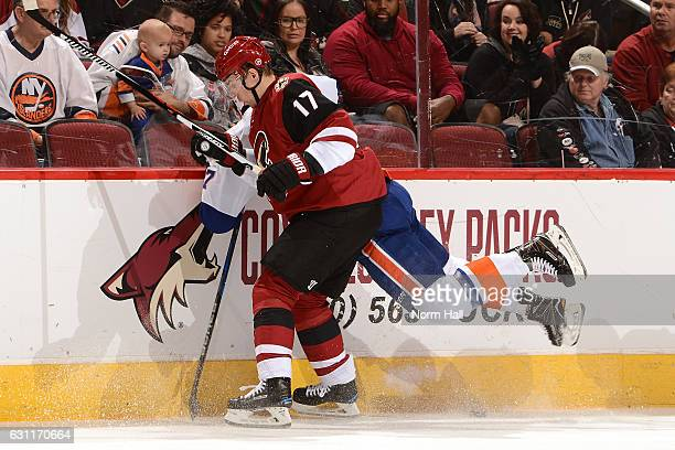 Radim Vrbata of the Arizona Coyotes checks Anders Lee of the New York Islanders into the boards during the first period at Gila River Arena on...