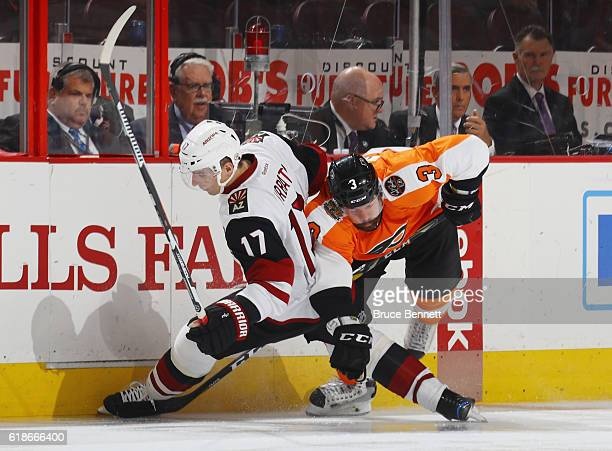 Radim Vrbata of the Arizona Coyotes is hit by Radko Gudas of the Philadelphia Flyers during the second period at the Wells Fargo Center on October 27...