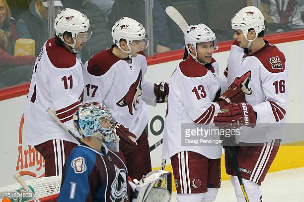Radim Vrbata of the Phoenix Coyotes celebrates his second period goal against goalie Semyon Varlamov of the Colorado Avalanche with teammates Martin...