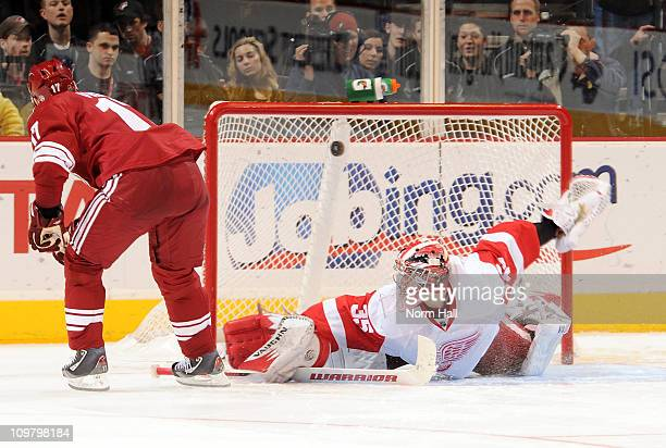 Radim Vrbata of the Phoenix Coyotes gets the gamewinning shootout goal over a sprawling Jimmy Howard of the Detroit Red Wings on March 5 2011 at...